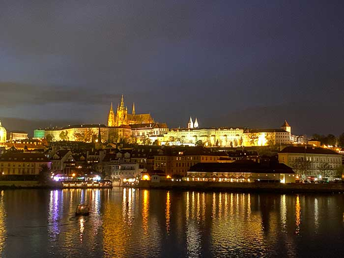 Reflections of the past: The Vltava River and Castle in Prague, Czech Republic